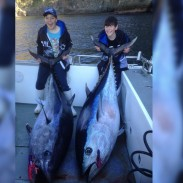 Sam (left) and Toby (right) Nichols are overjoyed with their recent tuna catches.
