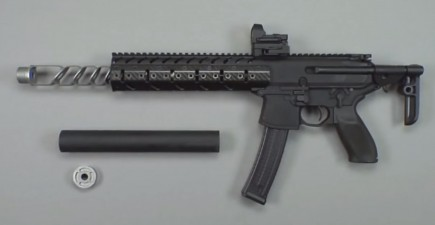 The Sig Sauer MPX-C Carbine, along with its permanently attached muzzle brake, silencer tube, and steel end plate.