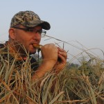 Joe Robison calls geese from a blind on the edge of a sweet corn stand.
