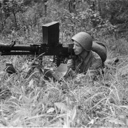 In this photo taken on August 2, 1941, a Finnish solider looks down the sights of a 20mm Lahti L-39 anti-tank rifle.