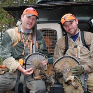 Fritz Heller, left, and his brother Ric compare Michigan grouse.