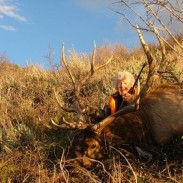 Margaret Lunt proudly poses with her first bull elk in about three decades of hunting.