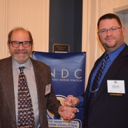 Lew Danielson, Crimson Trace Founder (left), and Nate Hoke, Crimson Trace Customer Service Director, with PNDC award.