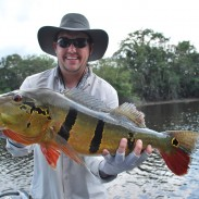 The author with a peacock bass he caught on a recent fishing trip in the Amazon rain forest. Image courtesy of Colin Anthony.