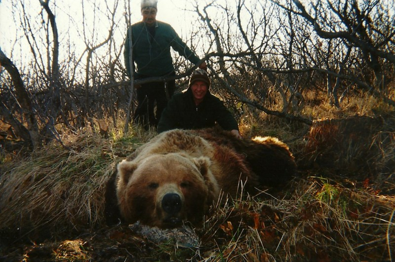 The author (foreground) and cook Paul Johnson with the massive bear.
