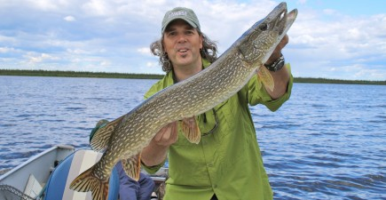 The author with a trophy pike caught in Manitoba. Image courtesy of Scott Gardner.