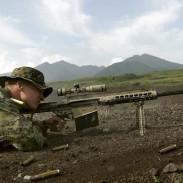 A US Marine behind a Barrett M82A3 rifle.