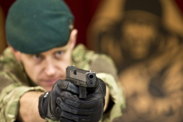 Glocks are favored by many military and police units around the globe, but will the US Army be the next to adopt it as a sidearm? Shown here is a UK Royal Marine with a Glock.