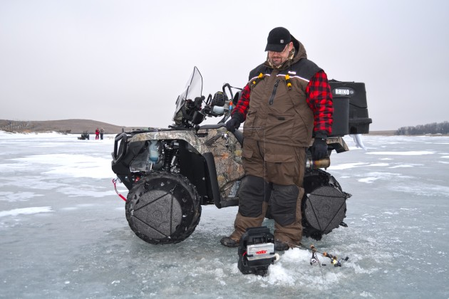 Staying warm keeps you out and fishing. Gear, such as the Frabill I-3 Ice Suit, make the difference for long days (and nights) on the ice.