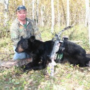 My buddy Ron with one of several bears we have shot at Narrows Outfitters in Manitoba.