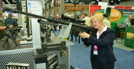 NRA Annual Meeting visitor Vel Byers, a journalist from Hagerstown, Maryland, eyeing up her next squirrel rifle.