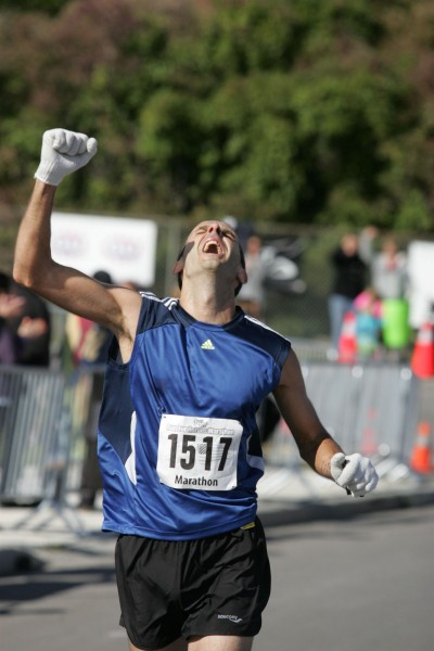 A runner crosses the finish line at the Run for Heroes Marathon in Amherstburg, Ontario.