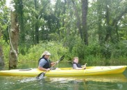 My grandson Charlie, right, and our Watauga Kayak river guide, Teresa. Her smile shows she loves what she does.