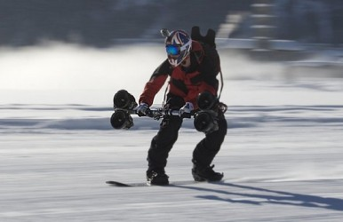 A snowboarder testing out the Thruster.