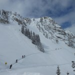 Skiers make their way into Honeycomb Canyon at Solitude.