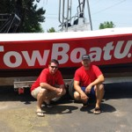 Capt. Jerry Mitchell (L) and Capt. Skip Peterlin (R) with their towboat.