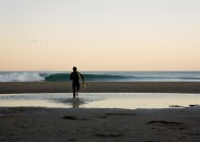 Dan Malloy makes his way to the waves. Image by Chris Burkard.