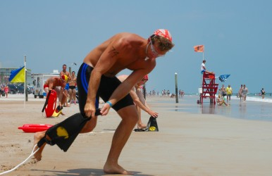 Lifeguards must paddle, swim, and run during the competition.
