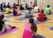 Yoga teacher Amy Brusca teaching mindfulness to middle school students.