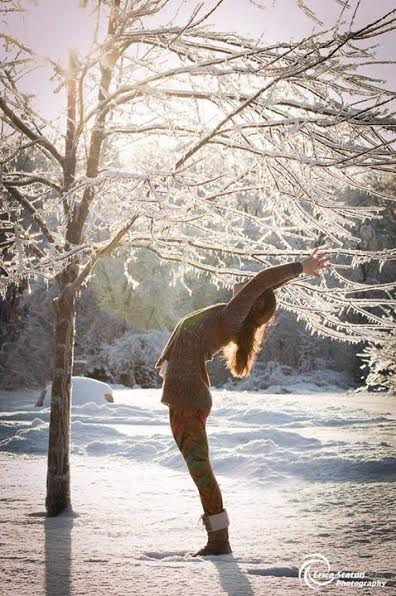 Deanna Staton doing a back bend in the snow.