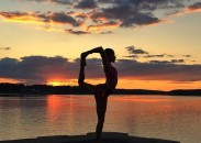 Yulady Saluti in dancer pose at sunset.