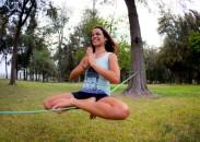 Raquel Hernandez in lotus pose on a slackline.