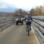 Mountain bikers and OHRV riders share a bridge in Gorham, New Hampshire.