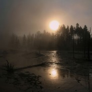 Solar coronae over hot springs in Yellowstone National Park. Image by Brocken Inaglory.