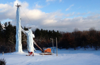 Peabody Ice Climbing Club's towers sit in the middle of an apple orchard.