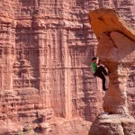 Alex Honnold in the midst of the red rock.