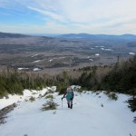 A hiker ascend Maine's Baker Mountain. Image courtesy of Appalachian Mountain Club.
