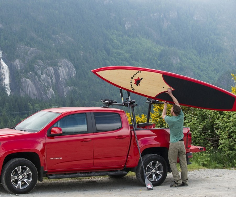 Loading up a Beaver Board, a stand up paddleboard brand made in Squamish.