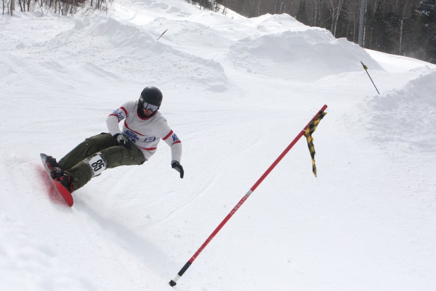 Snowboarders test their skills during the Sugarloaf Banked Slalom in Maine. Image courtesy of Sugarloaf.