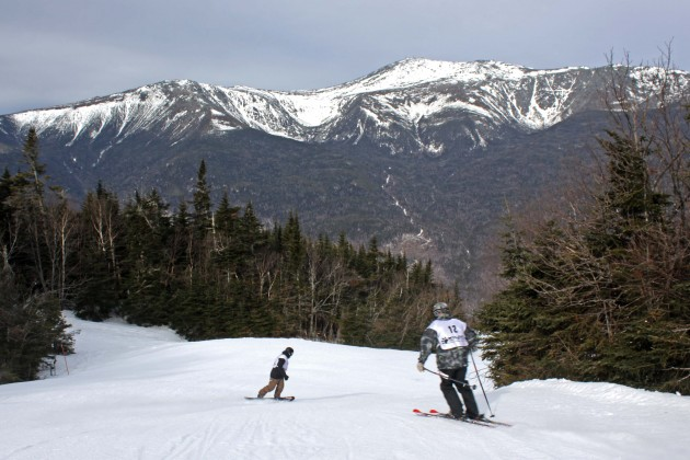 Jim Fagone  (bib no. 12) skis down the course during the 13th Annual 100,000 Vertical Foot Challenge to benefit Make-A-Wish New Hampshire at Wildcat in Pinkham Notch, New Hampshire.